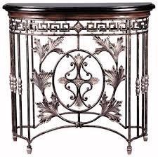 with its assortment of painstakingly forged acanthus leaves scrolling ironwork and black fossil stone sofa tablesend