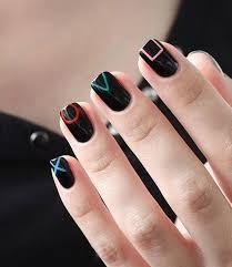 playstation controller inspired black nail art design perfect nail art design for short nails as