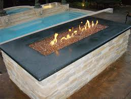 copper reflective diamond fire glass installed in an outdoor fire pit