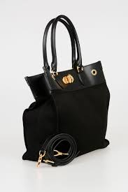 leather and canvas turnlock tote bag