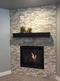 nice looking electric fireplace ideas with tv above and corner fireplace with silver travertine stacked stone surround and