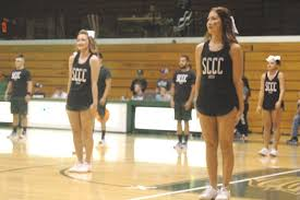 photo essay saints basketball captures victory over on point prep the saintsations dance team takes the floor at half time to perform a routine and