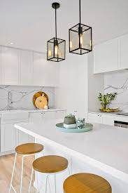 hamptons lighting perth. stunning hamptons style kitchen by three birds renos!love the sleek white cabinetry with marble look back splash and black pendant lights lighting perth
