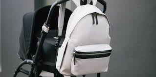 a backpack diaper bag and a stroller both gifts for second es