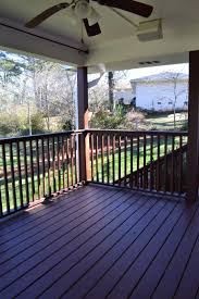 new covered deck with ceiling fan and outdoor speakers