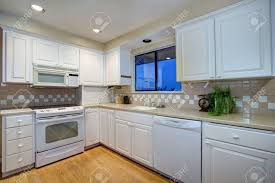 white kitchen design shaker cabinets paired cream counter quartz countertops stock photo beige subway tile backsplash colored ideas pictures gray solid grey