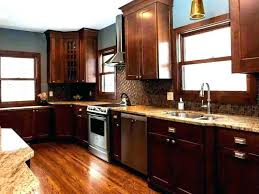grey walls brown cabinets kitchen light