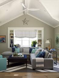 photos hgtv beach living room with gray sectional sofa and striped shade dining room light beach house furniture decor