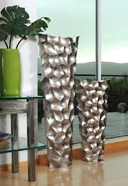 Stone Age Floor Vases Set. This original design features a dove grey  lacquer finish that