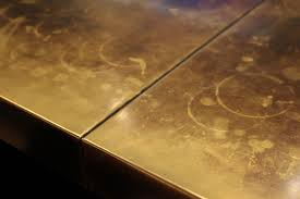 brass countertop with spots
