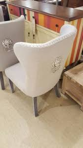 fabric covered chrome studded dining chairs with clic lion knocker dreamy