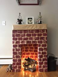 cardboard fireplace with real wood and lights as fire love love