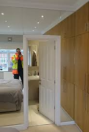 unframed bedroom mirror wall installation with polished edge work cricklewood glasirror fitters london