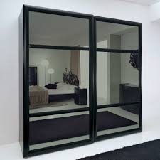 black glass wardrobes within preferred awesome black wardrobe sliding doors badotcom gallery 15 of