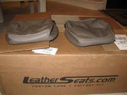 bought new leather seat covers 195 ls front head rests brown