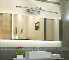 led bathroom lighting vanity with frameless mirror above single sink bathroom vanity in grey bathroom