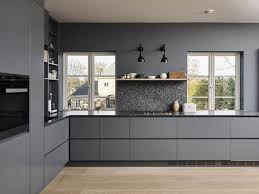 lundhs kitchen in grey and black with black appliances and wood accents