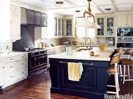 blue kitchen island brass pulls blue island white cabinets and brass accents