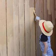 should i paint or stain my fence what