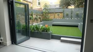 Small Picture modern small low maintenance garden fake grass grey raised beds