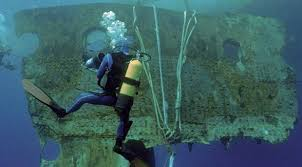 real underwater titanic pictures. A Diver Accompanies 17-ton Portion Of The Hull Titanic As It Real Underwater Pictures
