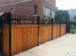wood fence with iron posts