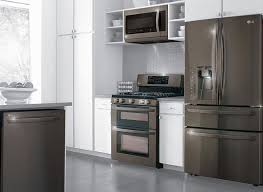 black refrigerator in kitchen. love the contracts of lg black stainless steel appliances against white kitchen cabinets and countertops! refrigerator in s