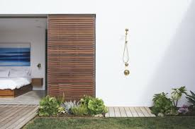 with the home being located just minutes from the beach the outdoor shower from kohler s