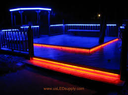 rgb flexible led strips lighting up an outside deck at their full brightness