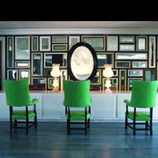 Green, Gold, Black and White with wall of mirrors