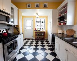 Inspiration for a timeless multicolored floor enclosed kitchen remodel in  Omaha with an undermount sink,