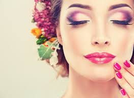 with delicate flowers in hair and fashion fuchsia nail