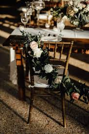 Chair back garland + golden hour light = picture perfect details!