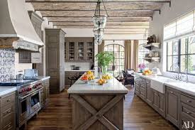 Pendant kitchen lighting Clear Glass Antique Tunisian Tile From Exquisite Surfaces Creates Lively Backsplash In This Kitchen Which Is Appointed With Formations Pendant Lights Architectural Digest 31 Kitchens With Pretty Pendant Lighting Architectural Digest