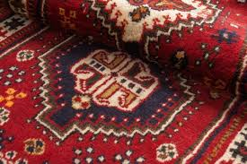 close up of the central part of a persian shiraz runner oriental carpet