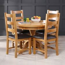 solid oak round 4 seater dining table 4 cross back oak chairs