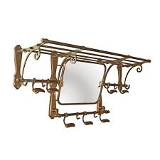 Coat Hook Rack With Mirror This vintage train luggage rack in antique brass finish features a 22