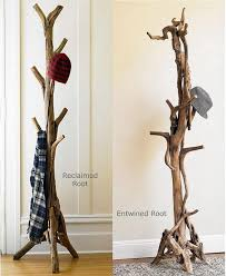 ... DIY tree-shaped coat rack made of wooden base and tree branches,  exposed brick wall, modern entryway ideas