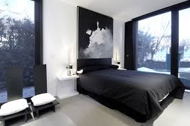 black and white bedroom design with white walls two black chairs with white cushions