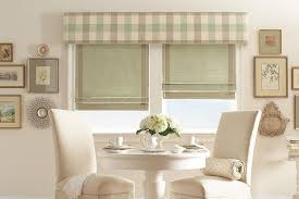 delicious complementary fabrics in roman shades and cornice board