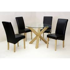 saturn dining table round clear glass solid oak legs four black leather chairs