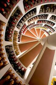 A spiral cellar is an ingenious way to house a wine collection, perfect for  urban homes where space is often limited. The cellar can be installed in ...