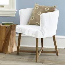 white club chair slipcover for reading chair which has unfinished wood legs tree trunk side table