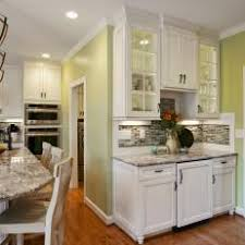 kitchens with white cabinets and green walls.  Cabinets Traditional Kitchen With Marble Countertops And Wrought Iron Pendant  Lighting Throughout Kitchens White Cabinets And Green Walls A