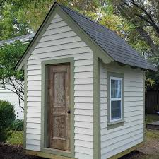 a small playhouse with a window and doora small playhouse with a window and door