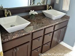 granite for bathroom vanity. builder grade bathroom vanity makeover -stained and mirror frame, spray painted light fixture, added granite counters, new sinks, hardware for a