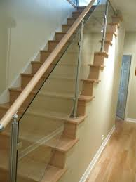 wood stairs and stainless steel glass railings contemporary staircase