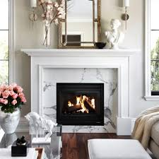 designed by the design company lovely living room with a white fireplace mantel and beautiful