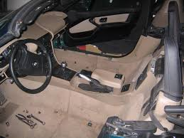 2 take your radio out if you have the original bmw set youll need a special 5 star tip screw driverhopefully youve done this before so you know what black interior 1996 bmw z3