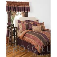 this matching collection has subdued stripes of rose pink orange purple and taupe these stripes are stitched with gold embroidery